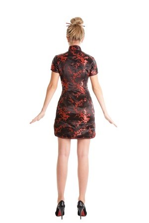 woman back view: Young slender blonde woman portrait in oriental style posing like doll Stock Photo