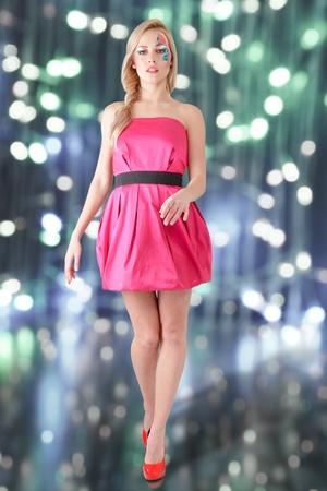 long sexy legs: Walking beautiful fashion model in pink short dress with long sexy legs