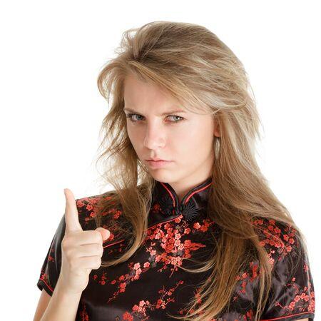threatens: Young blonde girl threatens finger