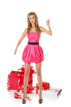 Fashion model in pink mini dress posing like doll photo