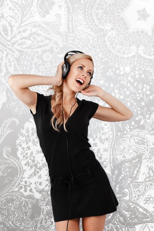 choreographer: Young blonde woman listening music in headphones