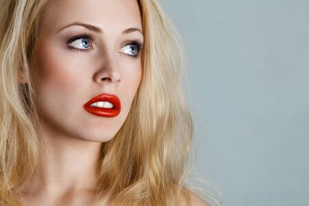sexy mouth: Young blonde woman portrait looking sidewards