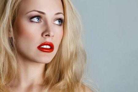 sidewards: Young blonde woman portrait looking sidewards