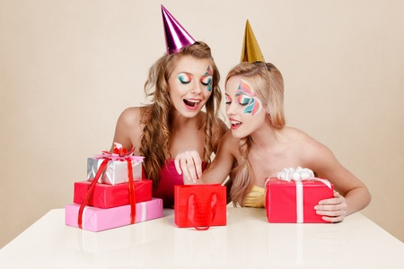 Two young blonde women celebrating birthday Stock Photo - 11969679
