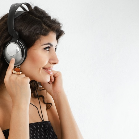 sexy headphones: Smiling young woman listening music in headphones Stock Photo