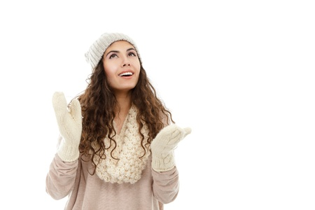Happy young winter woman in hat photo