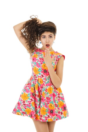 Surprised young woman in mini dress photo