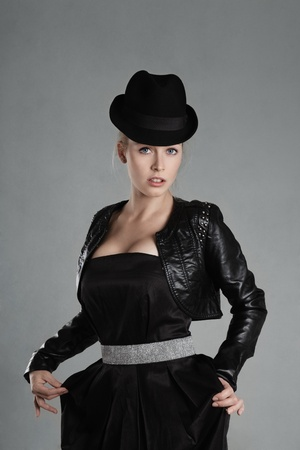 uplift: Blonde young woman in black leather jacket and hat