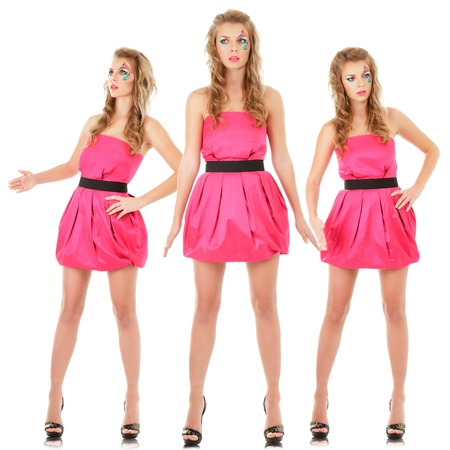 Digital composite of small group fashion models in pink mini dress posing like doll photo