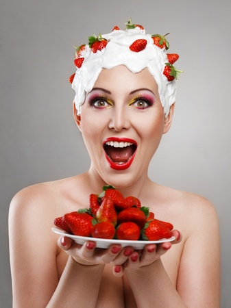 ripeness: Happy woman with hairstyle made from milk and red ripe strawberry