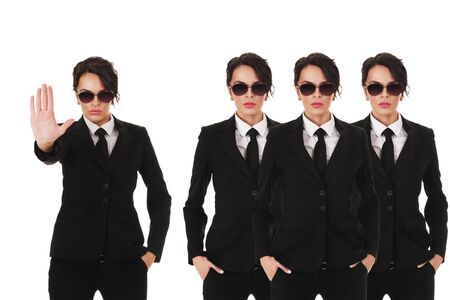 Group of young secret service agents or police officers isolated over white background Stock Photo - 12285820