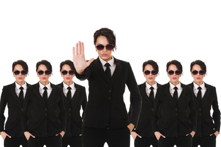 Group of young secret service agents or police officers isolated over white background Stock Photo - 12285814