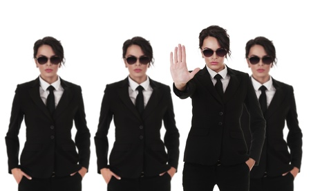 Group of young secret service agents or police officers isolated over white background Stock Photo - 12285817