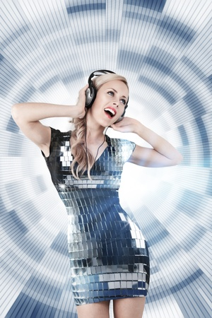 Young blonde woman listening disco music in headphones