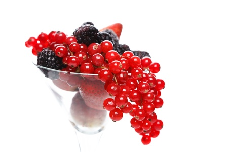 ripeness: Berry cocktail in martini glass isolated over white background