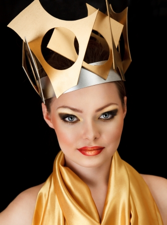 Sexy fashion model in golden dress and creative crown on head Stock Photo - 12517067
