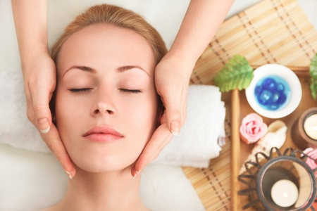 gets: Young sexy woman in spa gets a facial massage