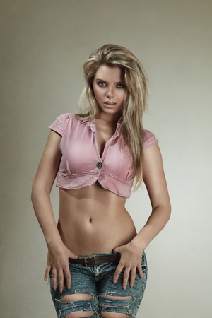 jeans girl: Young blonde woman with slim waist and flat abs