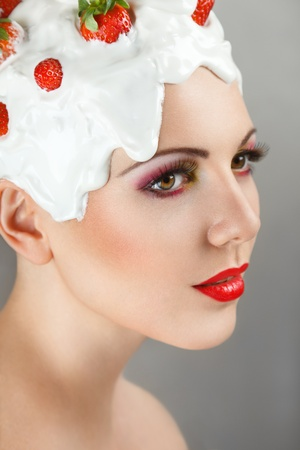 ripeness: Young woman with hairstyle made from milk and red ripe strawberry Stock Photo