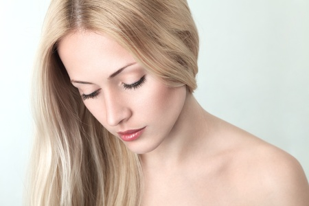 woman looking down: Sensual young blonde woman with long hair looking down