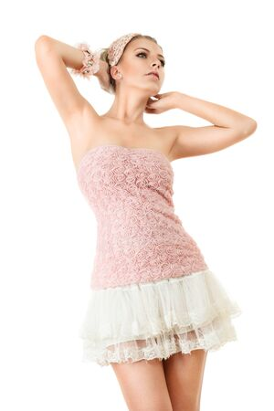 sidewards: Young woman in pink clothing and white mini skirt looking up and sidewards