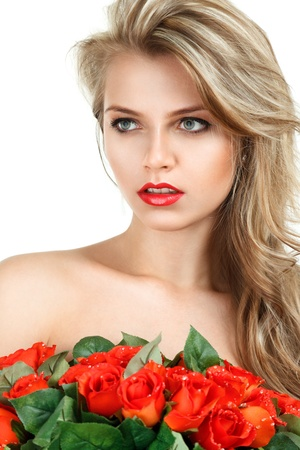 sidewards: Young blonde woman with false red flowers isolated over white Stock Photo