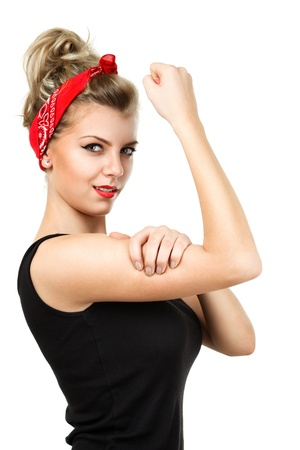 Young pin-up blonde woman like classic We Can Do It poster isolated over white background photo