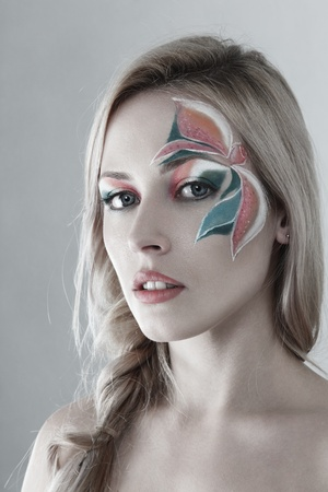 Young attractive woman with creative floral make-up photo