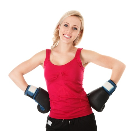 Young blonde happy smiling woman in boxing gloves photo