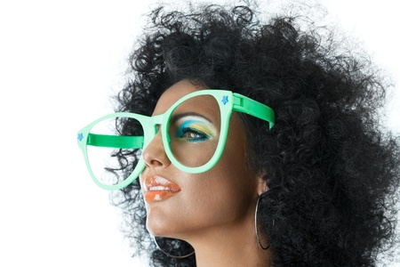 sidewards: Woman with curly hair and big clown glasses Stock Photo