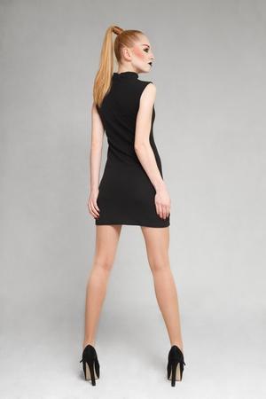 Young blonde fashion model posing for lookbook portfolio