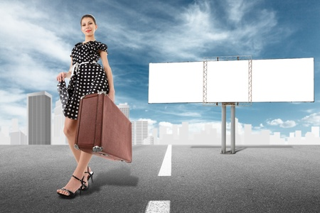 one way sign: Young retro style woman walking against cityscape and empty billboard