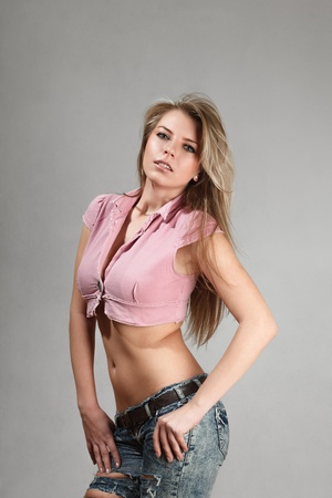 topic: Young blonde woman with slim waist and flat abs