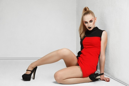 Young blonde fashion model sitting on floor  posing for lookbook portfolio photo