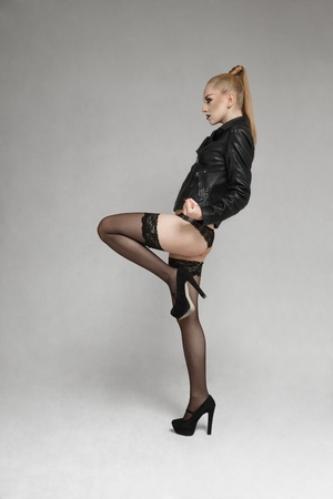 girl kick: Young blonde fashion model posing for lookbook portfolio