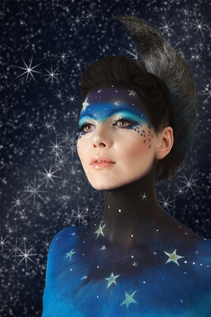 Young fashion model with fantasy moon make-up photo