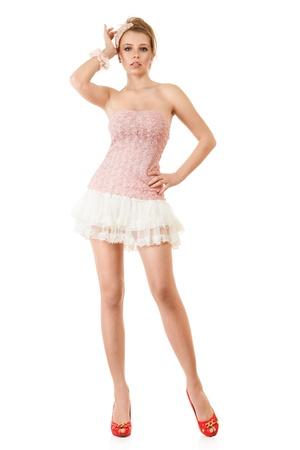 minifalda: Esbelto modelo de moda joven en el vestido rosa y mini falda Foto de archivo