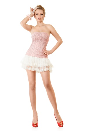 mini falda: Esbelto modelo de moda joven en el vestido rosa y mini falda Foto de archivo