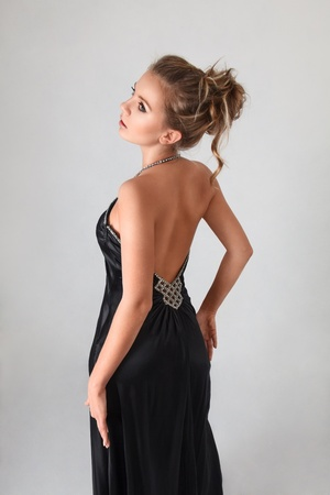 Attractive young blonde woman looking over shoulder rear view photo