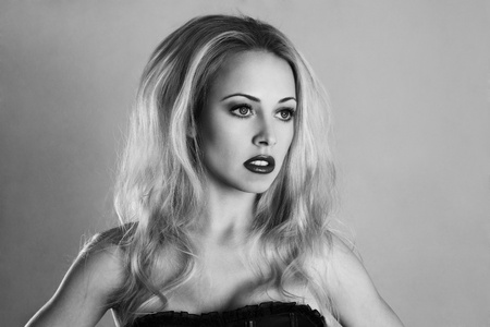 sidewards: Young sexy blonde girl fashion black and white studio portrait