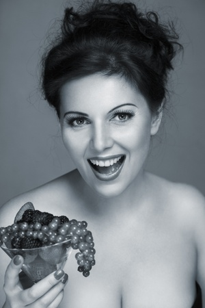Happy smiling young woman with fruits cocktail black and white studio portrait Stock Photo - 13548418