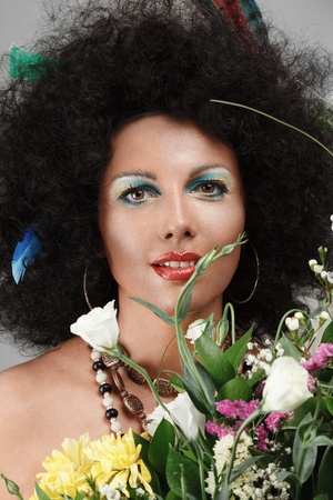 Fashion model made make-up african style with bouquet flowers Stock Photo - 13826021