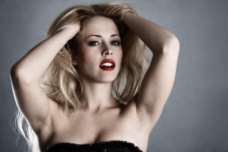 Young sexy blonde girl with bright red lips fashion portrait photo