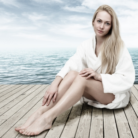 woman sitting floor: Young blonde woman relaxing in SPA