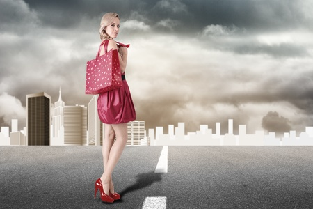 Young blonde fashion model with shopping bag Stock Photo - 14210056