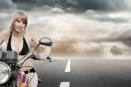 Biker girl riding a motorcycle photo