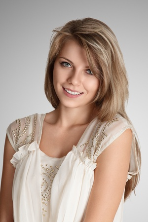 Beautiful blonde young woman studio portrait