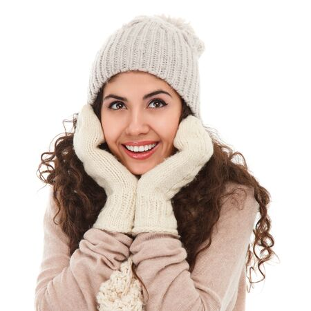 Studio portrait of happy young woman in winter clothing isolated on white background photo