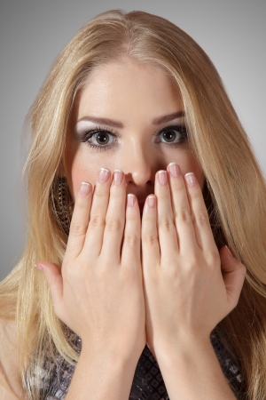 alluring: Pretty surprised woman with hands over mouth