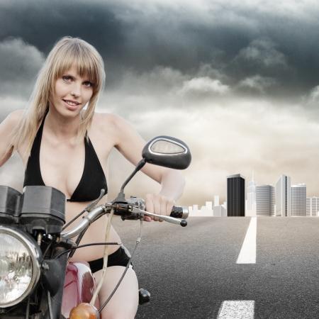 Biker girl riding a motorcycle photo